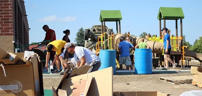 People building playground image